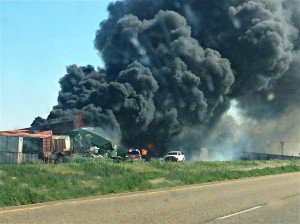 Two trains collided Sunday near the Oklahoma Panhandle town of Goodwell, sparking a diesel fire and forcing the closure of a stretch of highway. Three people were missing.