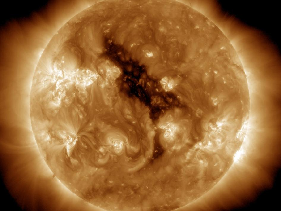 This image of a coronal hole on the sun bears a remarkable resemblance to the 'Sesame Street' character Big Bird. Coronal holes are regions where the sun's corona is dark. These features were discovered when X-ray telescopes were first flown above the Earth's atmosphere to reveal the structure of the corona across the solar disc. Coronal holes are associated with 'open' magnetic field lines and are often found at the sun's poles. The high-speed solar wind is known to originate in coronal holes. The solar wind escaping from this hole will reach Earth around June 5-7, 2012.