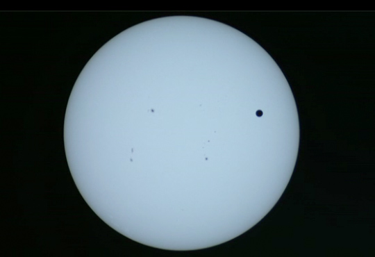 live image from nasa monitoring venus transit cross the Sun June 5th 6th 2012 Tuesday Wednesday