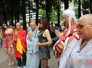 Is that Shaolin monk or some monk looking at down a girl's bra or breast that I'm seeing? Is it just an accident when the camera shutter capture the image where his eye looking down at the girl's bosom?