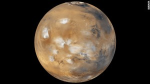 Water-ice clouds, polar ice and other geographic features can be seen in this full-disk image of Mars from 2011. NASA's Mars Curiosity Rover touched down on the planet on August 6. Take a look at stunning photographs of Mars over the years