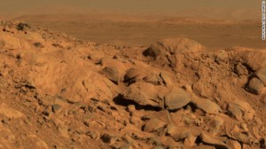 A rock outcrop dubbed Longhorn and the sweeping plains of the Gusev Crater are seen in a 2004 image taken by the Mars Exploration Rover Spirit.