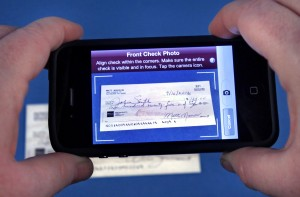 deposit check by taking picture from your mobile phone android tablet iphone simply sign it and take picture of it and voila money in the bank