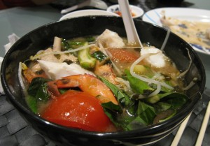 various dishes of canh chua vietnamese sour soup