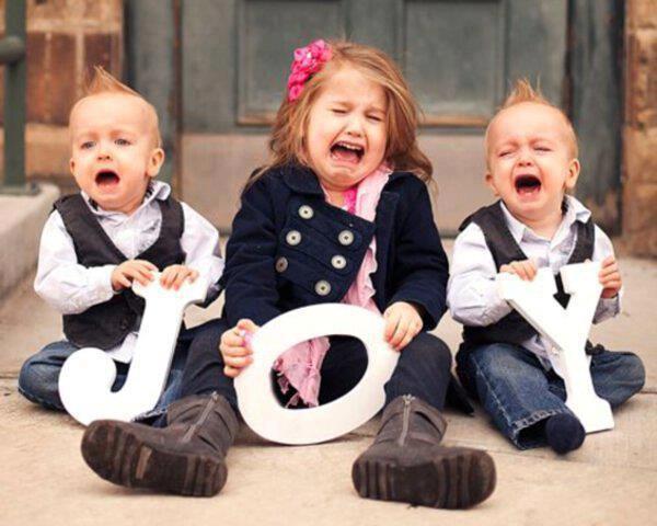 funny joyful kids laughing crying holding joyful letters J O Y Merry Christmas 2012