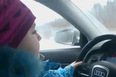 8 years old driving on icy road while father film it for youtube viral video