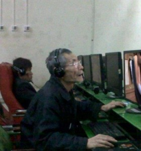 elderly playing computer internet online gaming Go Cong Tien Giang Tan Thoi Tan Phu Dong