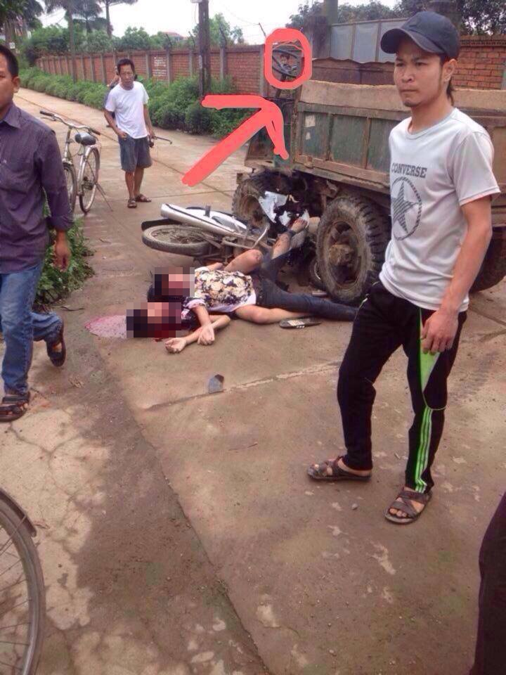 this fatal accident killed two people riding motorcycle while the image capturing a ghost looking down at the bodies