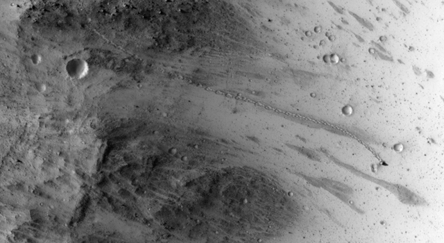 planet Mars underground lives came up and pushed a bolder over rolled down the hill captured by satellite orbiting on Mars